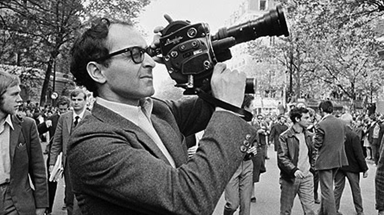 Godard with a camera, sometime in those black-and-white days.
