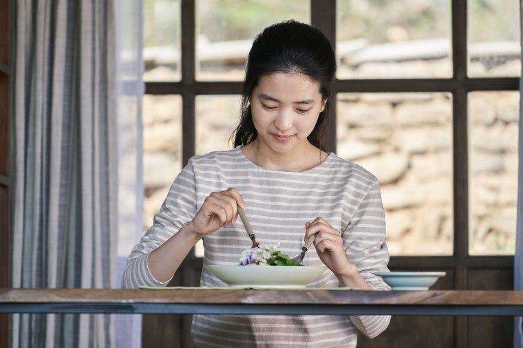 A young Korean woman prepares food