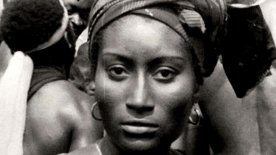 An African woman looks out at the camera
