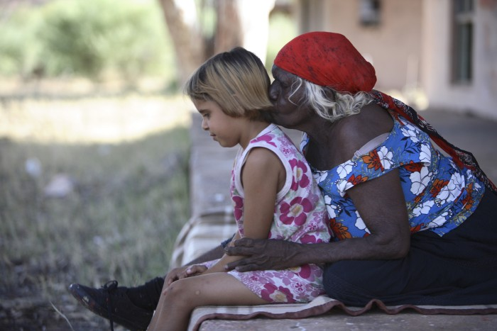 An older Aboriginal woman with a child