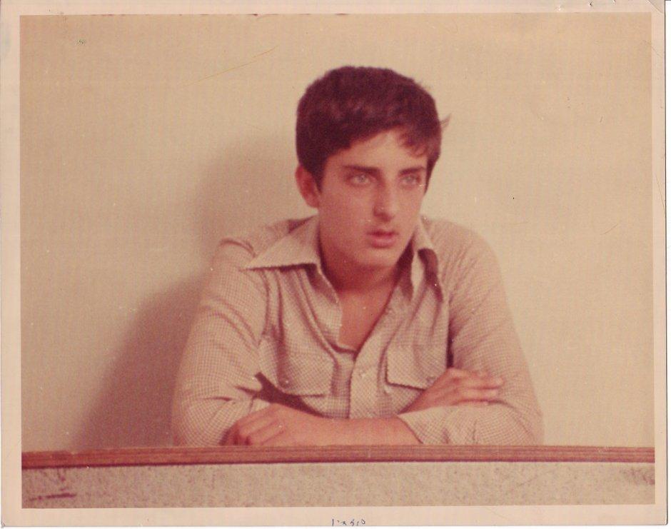 A schoolboy sits at his desk