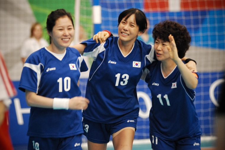 Three Korean handball players on court