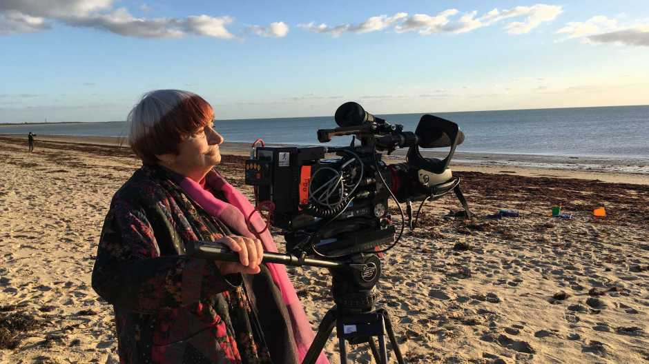 Varda uses a camera on a beach