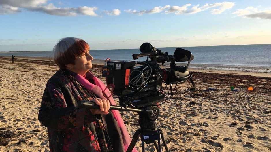 Varda uses a camera on a beach