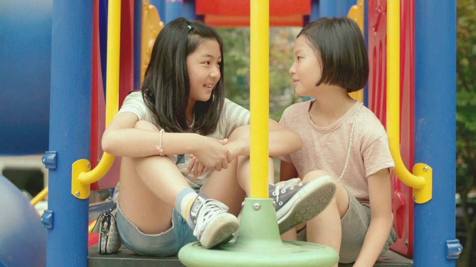 Two young Korean girls in a playground