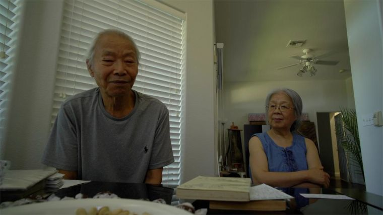 An elderly Chinese man with his wife